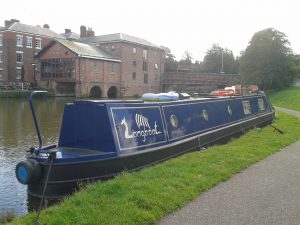 "Typical ""Narrowboat"" in Chester (Background: Telford's Warehouse (Pub))"